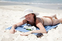 Woman enjoys summer day at tropical island. Stock Photo