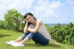 Woman enjoys summer sun. Attractive young woman enjoys summer sun Royalty Free Stock Image