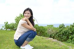 Woman enjoys summer sun. Attractive young woman enjoys summer sun Stock Images