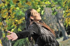 Woman enjoys sun in autumn time Royalty Free Stock Images