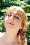 Woman enjoys sun beams Royalty Free Stock Image