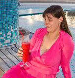 Woman enjoys traveling on cruise ship. Sipping a cocktail Stock Photo