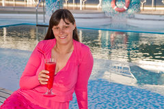 Woman enjoys traveling on cruise ship sipping a cocktail Stock Photo