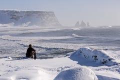 Woman enjoys view o three pinnacles of Vik, Iceland Royalty Free Stock Photo
