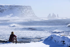 Woman enjoys view o three pinnacles of Vik, Iceland Stock Images