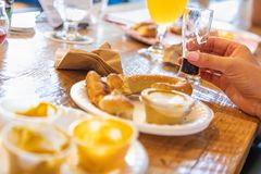 Woman Enjoys Warm Pretzels and Micro Brew Beer. At a Bar royalty free stock images