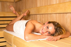 Woman enjoys wellness day in a sauna Royalty Free Stock Photos