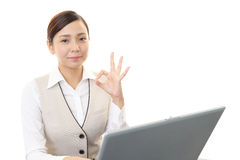 The woman enjoys working Royalty Free Stock Photo