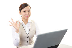 The woman enjoys working Royalty Free Stock Image