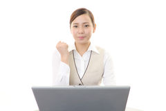 The woman enjoys working Stock Image