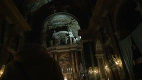 Woman entering Catholic church stock video