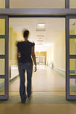 Woman entering a hospital Stock Image