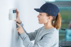Woman entering pin code. Woman entering the pin code royalty free stock images