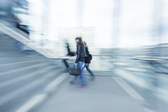 Woman entering stairs, blue toned image Royalty Free Stock Photos