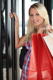 Woman entering in a store Royalty Free Stock Photos