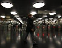Woman entering a subway station. Royalty Free Stock Photo