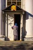 Woman enters church stock photos