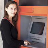 Woman enters PIN number at ATM Stock Image