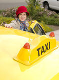 Woman enters a Yellow Taxi Downtown Royalty Free Stock Images
