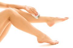 Woman epilating her leg Royalty Free Stock Photo