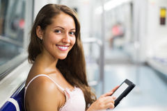 Woman with ereader in subway train Royalty Free Stock Photos