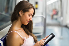 Woman with ereader in subway train Royalty Free Stock Images