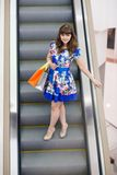 Woman on escalator Stock Photo