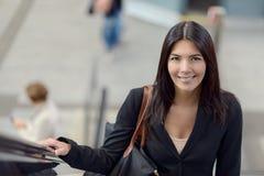 Woman on escalator Stock Images