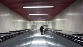 Woman on escalators stock footage