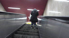 Woman on escalators Stock Photo