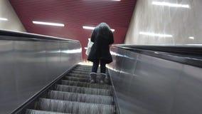 Woman on escalators stock footage