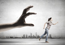 Woman escape from hand Stock Images