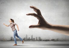 Woman escape from hand Stock Photos