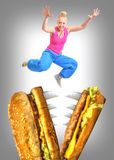 Woman escapes from angry hamburger Stock Photos