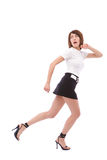 Woman escaping. Beautiful girl escaping from someone on white stock photo