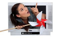 Woman escaping from a television Stock Photo