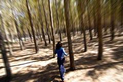 Woman Escaping Through The Woods Stock Photos