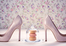 Woman essentials, fashion high heels. Macarons. Woman essentials fashion accessories. Macarons french dessert, luxury beige shoes high heels, pearl, ribbon Royalty Free Stock Images