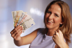 Woman with euro Stock Image