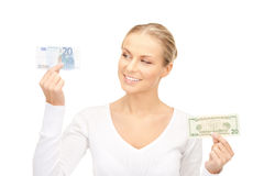 Woman with euro and dollar money notes Stock Image