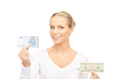 Woman with euro and dollar money notes Stock Photos