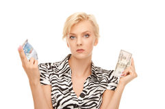 Woman with euro and dollar. Picture of woman with euro and dollar money notes royalty free stock image