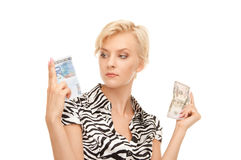 Woman with euro and dollar Royalty Free Stock Images