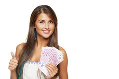 Woman with euro money. Closeup of young beautiful woman with euro money in hand gesturing thumb up sign, over white background royalty free stock photos