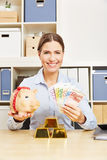 Woman with Euro money and gold and  piggy bank. Happy business woman with Euro money and gold and  piggy bank Royalty Free Stock Image