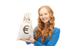 Woman with euro signed bag Royalty Free Stock Image