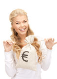 Woman with euro signed bag Royalty Free Stock Photography