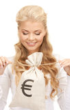 Woman with euro signed bag Royalty Free Stock Photo