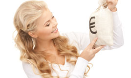 Woman with euro signed bag Royalty Free Stock Photos