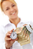 Woman with euro stacks and stopwatch Stock Photos